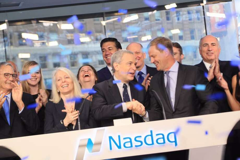Chicken Soup for the Soul Entertainment CEO Bill Rouhana Jr., center, on Friday during a Nasdaq market opening ceremony recognizing the Greenwich-based company's initial public offering of stock. Photo: /