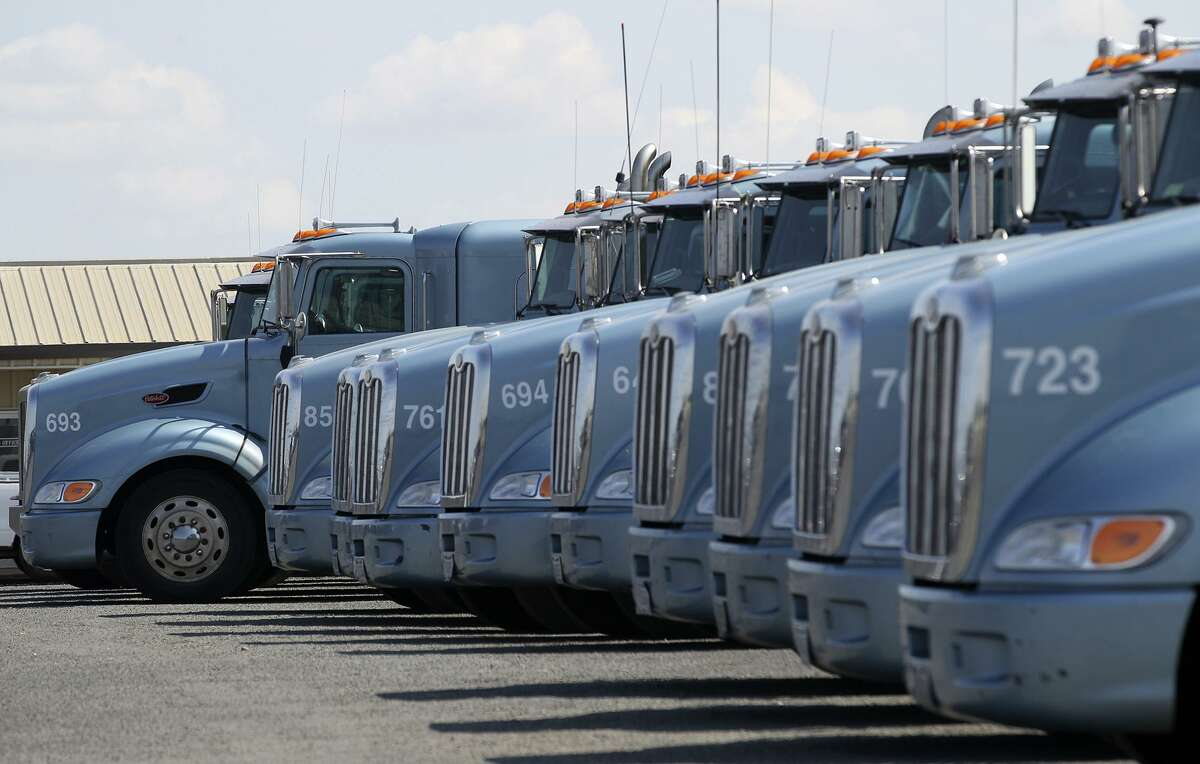 Trucks are lined up at Reynolds Nationwide trucking. Many truck companies are experiencing a shortage of truck drivers.