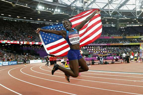 LONDON, ENGLAND - AUGUST 12:  Dawn Harper Nelson of the United States, silver, celebrates with an American flag after the Women's 100 metres hurdles final during day nine of the 16th IAAF World Athletics Championships London 2017 at The London Stadium on August 12, 2017 in London, United Kingdom.  (Photo by Patrick Smith/Getty Images)