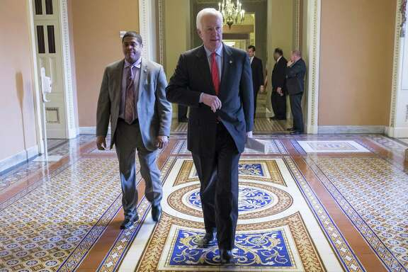 Senate Majority Whip John Cornyn (R-Texas) walks to the Senate Floor, at the Capitol in Washington, March 7, 2016. (Zach Gibson/The New York Times)