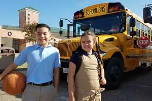 Milton Elementary students Rene Roman Rodriguez, 9, and Mia Rose Rodriguez, 8, are ready to go back to school. Authorities on Thursday reminded the community to avoid distracted driving and watch out for school buses.