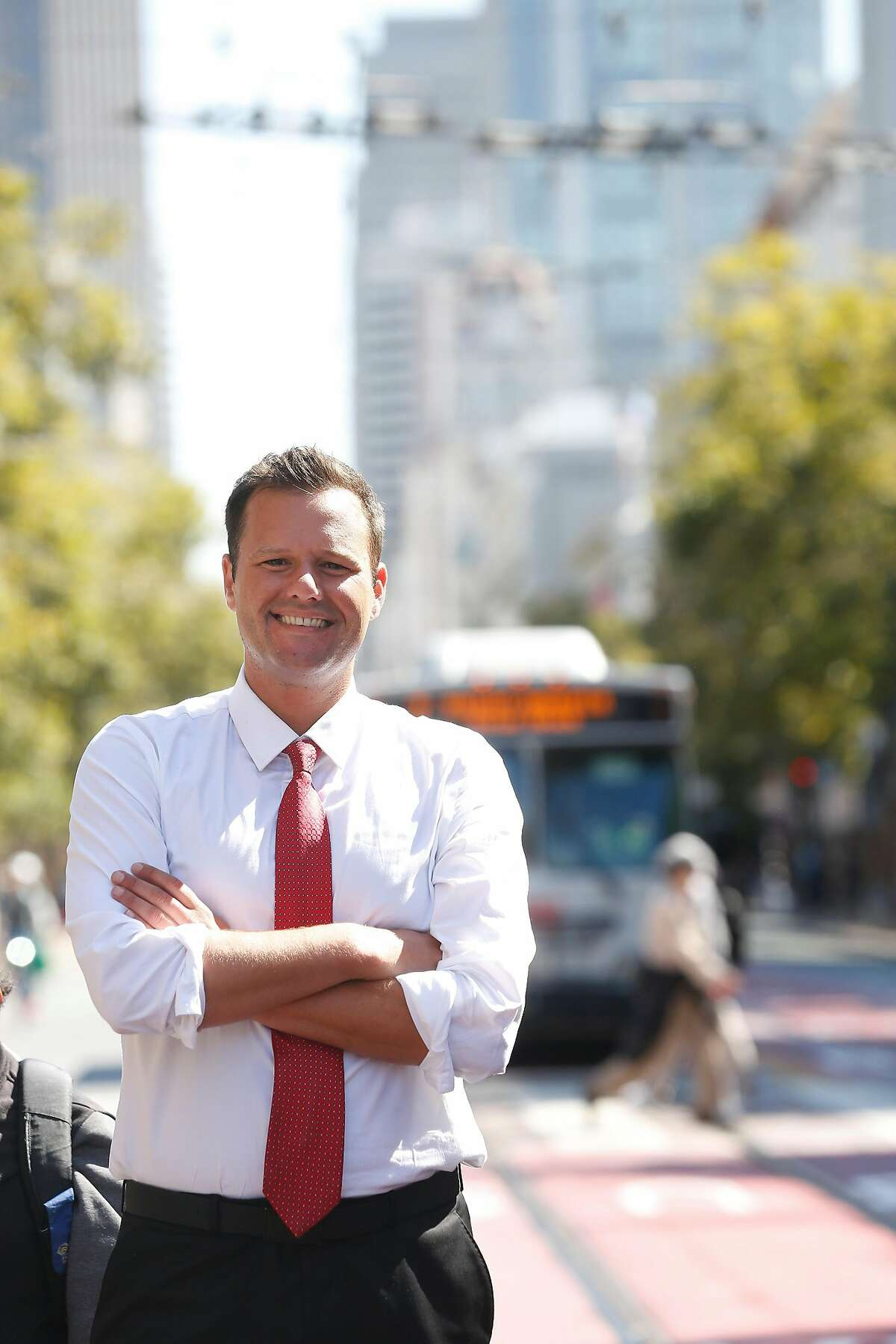 Matt Haney, San Francisco Board of Education commissioner and Dream Corps national policy director , stands on Market Street for a portrait on Monday, July 24, 2017 in San Francisco, Calif.