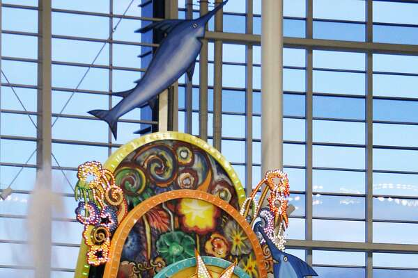 FILE - In this Aug. 28, 2012, file photo, the home run sculpture at Marlins Park lights up after Marlins' Justin Ruggiano hit a solo home run during the first inning of a baseball game against the Washington Nationals in Miami. The colorful home-run sculpture in Marlins Park doesn't get much use because the stadium is the toughest in the majors to hit a homer.  (AP Photo/Wilfredo Lee, File)