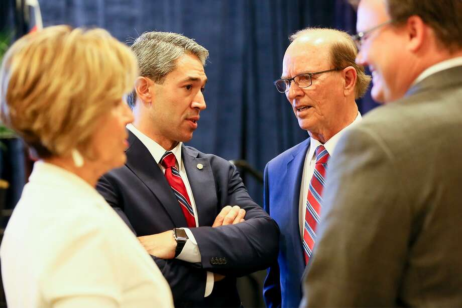 """Mayor Ron Nirenberg visits with County Judge Nelson Wolff (second from right), UIW President Dr. Thomas Evans (right) and City Manager Sheryl Sculley during the the """"Mayor's Vision for San Antonio"""" at the Hyatt Regency San Antonio Riverwalk on Friday, Aug. 18, 2017, where he announced plans for a cabinet that will design the framework for a housing plan that will address gentrification in San Antonio. Photo: Marvin Pfeiffer /San Antonio Express-News / Express-News 2017"""