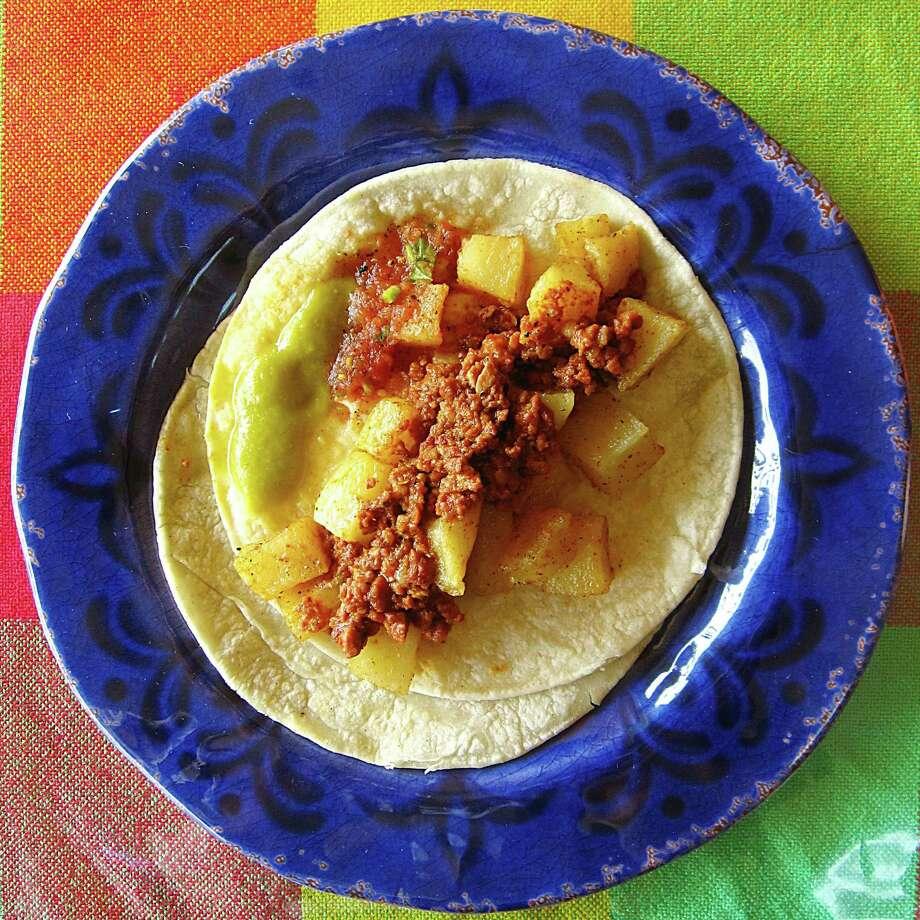 Chorizo and potato taco on corn tortillas from Picosito Mexican Cuisine. Photo: Mike Sutter /San Antonio Express-News