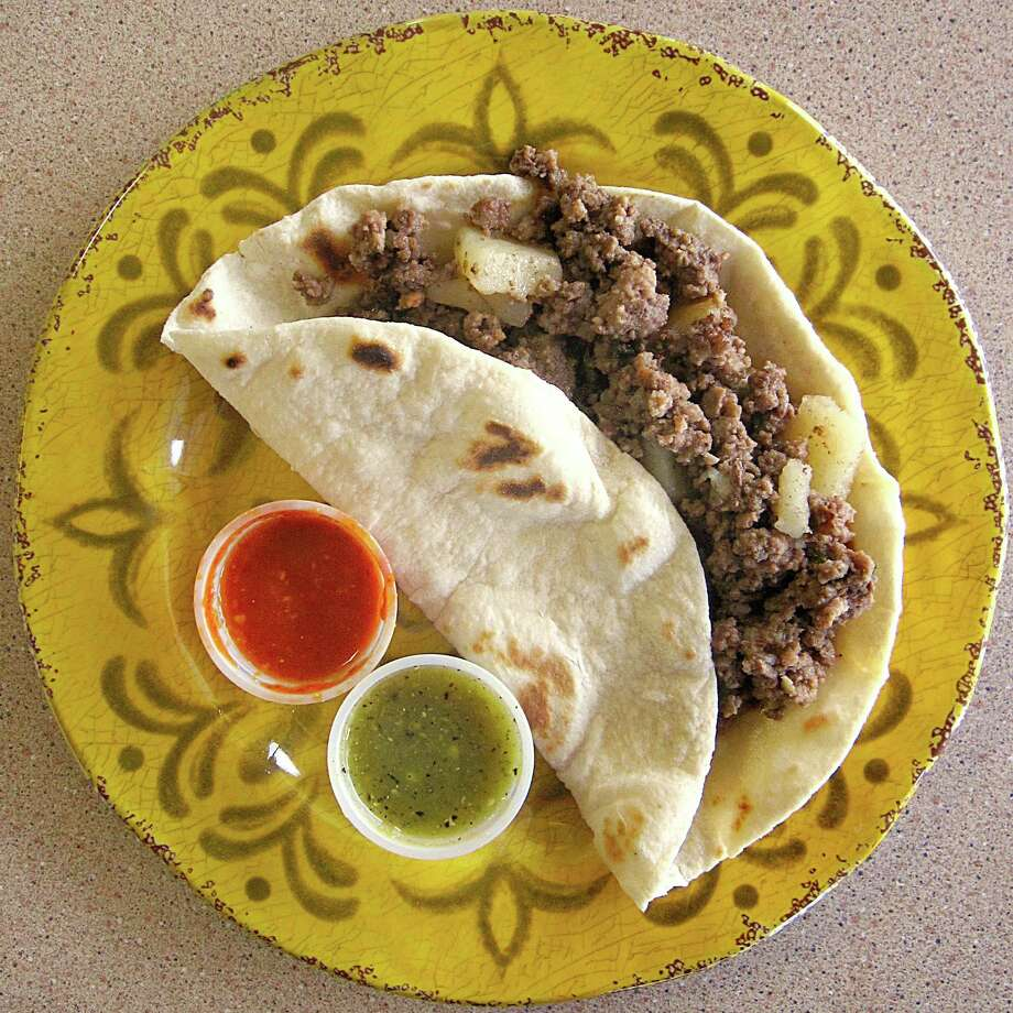 Beef picadillo taco on a handmade flour tortilla from Speedy Tacos. Photo: Mike Sutter /San Antonio Express-News