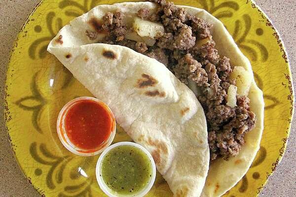Beef picadillo taco on a handmade flour tortilla from Speedy Tacos.