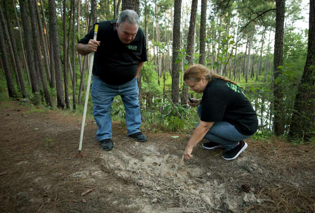 Russell Miller, left, and his wife, Michelle, of Baytown look for clues to Bigfoot at Sam Houston National Forest. Sometimes the couple camps overnight. In addition to the recording equipment they bring, their truck is decked out with a night-vision dash cam and LED light bars to pierce through the darkened woods.