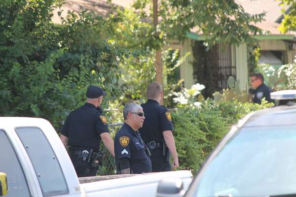 San Antonio police Search a West Side neighborhood for man wanted for aggravated robbery Friday Aug. 18, 2017.