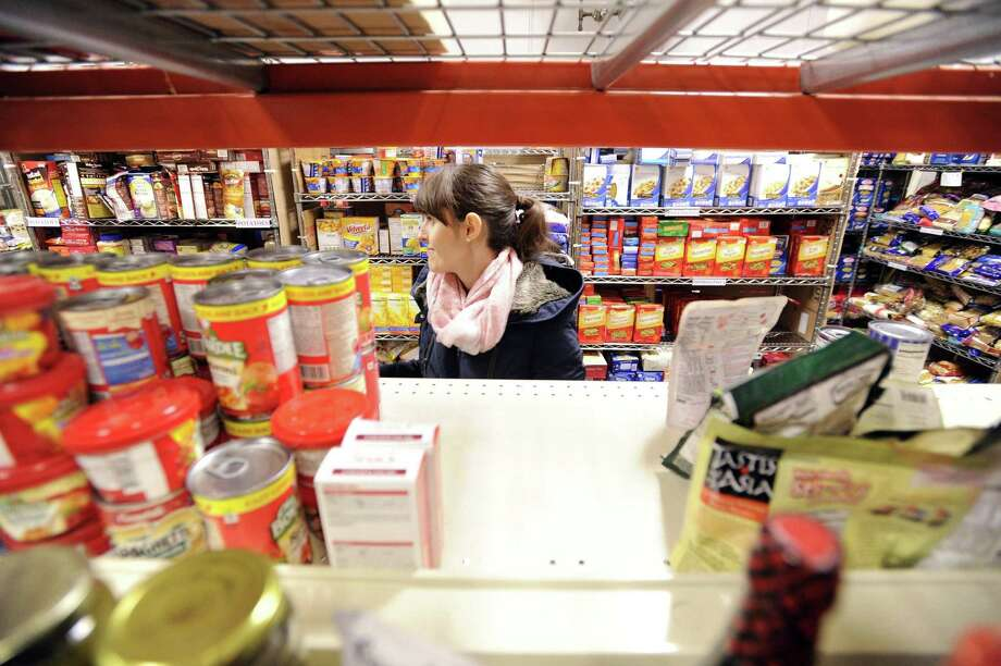Ina Hristova from Nestle Readyfresh Division works along side other employees volunteering at the Food Bank of Lower Fairfield County in Stamford on Dec. 16, 2016. Greenwich United Way has given the organization a $10,000 grant. Photo: Matthew Brown / Hearst Connecticut Media / Stamford Advocate
