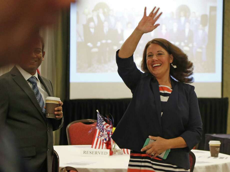 Tiffany Galindo recognizes someone before the start of the ceremony. The first local class of NS2Serves graduated on Friday at the Omni Hotel. The program seeks to equip veterans in a number of weeks with the technical skills necessary to get a job in big data analytics. Photo: Ron Cortes /