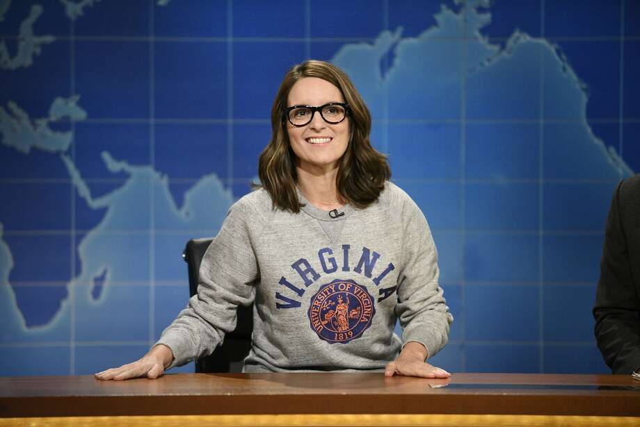 "This Aug. 17, 2017, photo provided by NBC shows Tina Fey on set during the an episode of ""Weekend Update: Summer Edition,"" in New York. Fey, a graduate of the University of Virginia, discussed last weekend's white nationalist rally near the school's Charlottesville, Va. campus, saying it broke her heart ""to see these evil forces descend upon Charlottesville."" Photo: Will Heath, Associated Press"