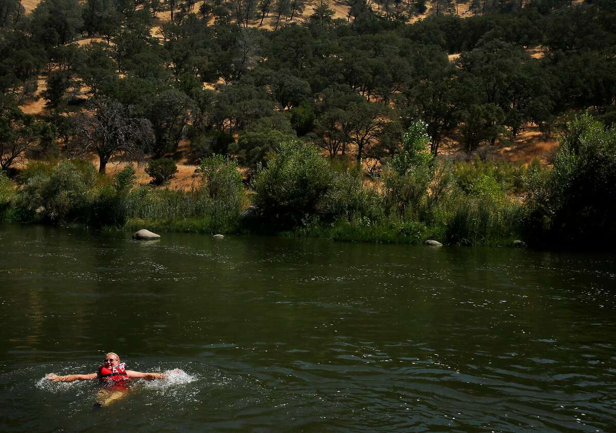 """Lori Carter swims in the Cache Creek as it winds through Berryessa Snow Mountain National Monument land while waiting for her family members to join her with blow-up tubes to float together down the river August 18, 2017 in Yolo County, Calif. """"We don't have a lot left in the world, so we need to hold on to what we have."""" Carter said of the Berryessa Snow Mountain National Monument land."""