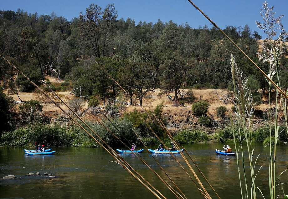 A group of kayakers navigate Cache Creek as it winds through Berryessa Snow Mountain National Monument land. Photo: Leah Millis, The Chronicle