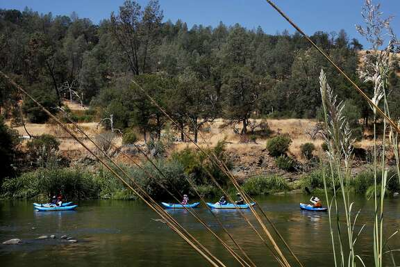 A group of local people kayak down the Cache Creek as it winds through Berryessa Snow Mountain National Monument land August 18, 2017 in Yolo County, Calif.