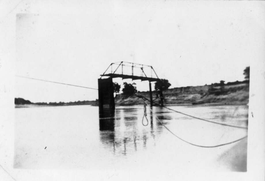 The Brazos River bridge in Rosenberg, shown after being damaged in a flood in 1922 Photo: Courtesy: The Fort Bend History Association., Courtesy: The Fort Bend History Association
