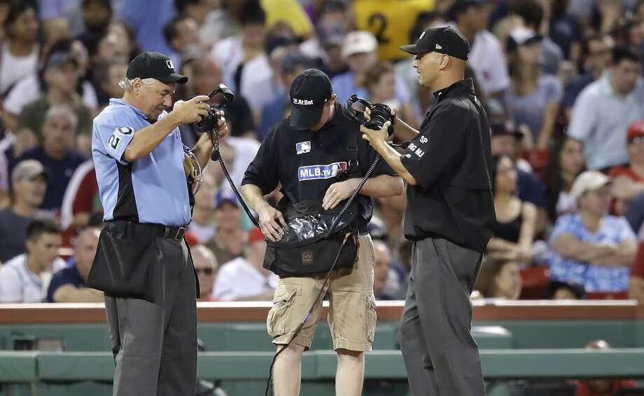 Umpires in Boston wait for a video review decision this week. Count A's manager Bob Melvin among those who believe reviews are taking too long and stopping games too often. Photo: Charles Krupa, Associated Press