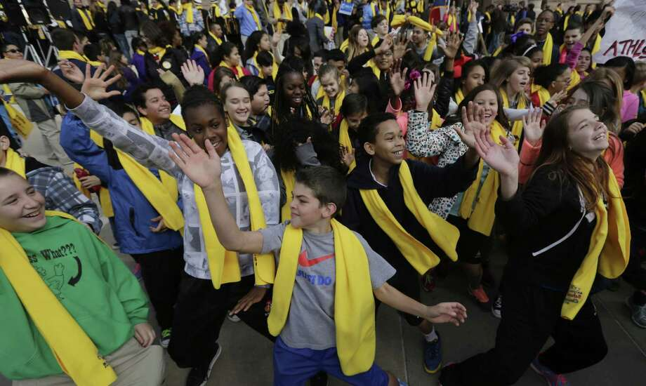 Students dance in front of the Texas Capitol during a school choice rally in 2015. School choice supporters called for expanding voucher programs and charter schools statewide. Charter schools in particular fill a niche ISDs don't. Photo: Eric Gay /AP / AP