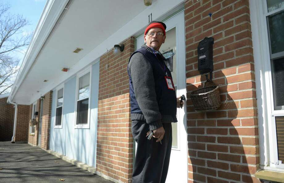 Tenant Floyd Banks walks into his unit in an elderly housing complex in Danbury, Conn. Criminal background checks help keep such tenants safe. Photo: Tyler Sizemore /Tyler Sizemore / The News-Times