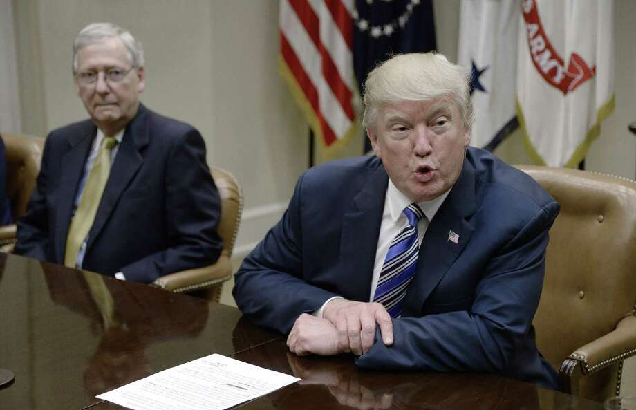President Donald Trump speaks as Senate Majority Leader Mitch McConnell looks on during a meeting with House and Senate leadership  June 6. Readers offer different takes on Trump and his administration. Photo: Olivier Douliery /Abaca Press / Abaca Press