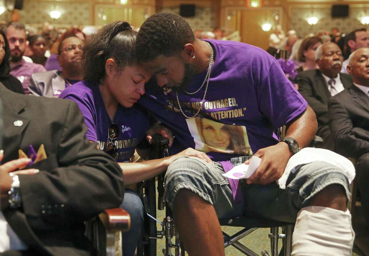 Marcus Martin and Marissa Blair hug during a memorial for Heather Heyer, killed when a car rammed into people protesting a white nationalist rally. The movement to remove Confederate icons will prosper - but slowly, over time. In all things racial, most white Americans prefer the gradualist path.