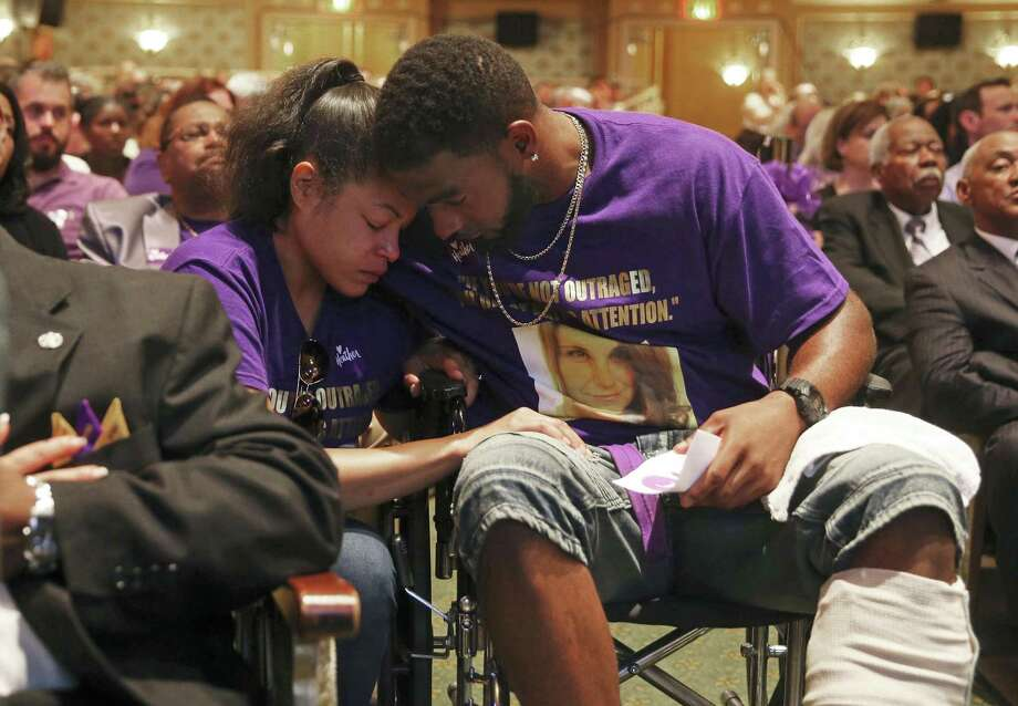 Marcus Martin and Marissa Blair hug during a memorial for Heather Heyer, killed when a car rammed into people protesting a white nationalist rally. The movement to remove Confederate icons will prosper — but slowly, over time. In all things racial, most white Americans prefer the gradualist path. Photo: Andrew Shurtleff / Getty Images / 2017 Getty Images