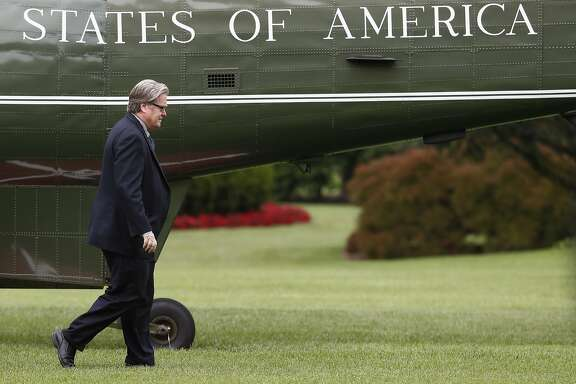 FILE - In this May 13, 2017 file photo, Steve Bannon, chief White House strategist to President Donald Trump, walks from Marine One on the South Lawn of the White House in Washington. According to a source, Bannon is leaving White House post.  (AP Photo/Carolyn Kaster, File)