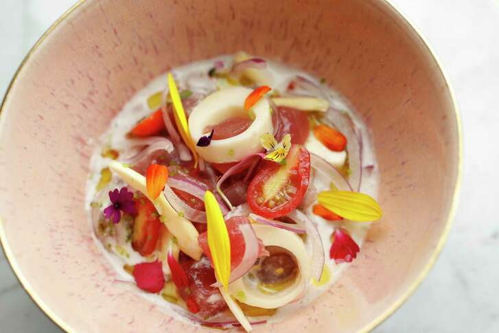 The Tuna Kinilaw, coconut, hearts of palm, jack fruit, coconut vinegar and coconut milk at James Beard Award-winning chef Paul Qui's new restaurant, Aqui, at 520 Westheimer, Friday, Aug. 18, 2017, in Houston.