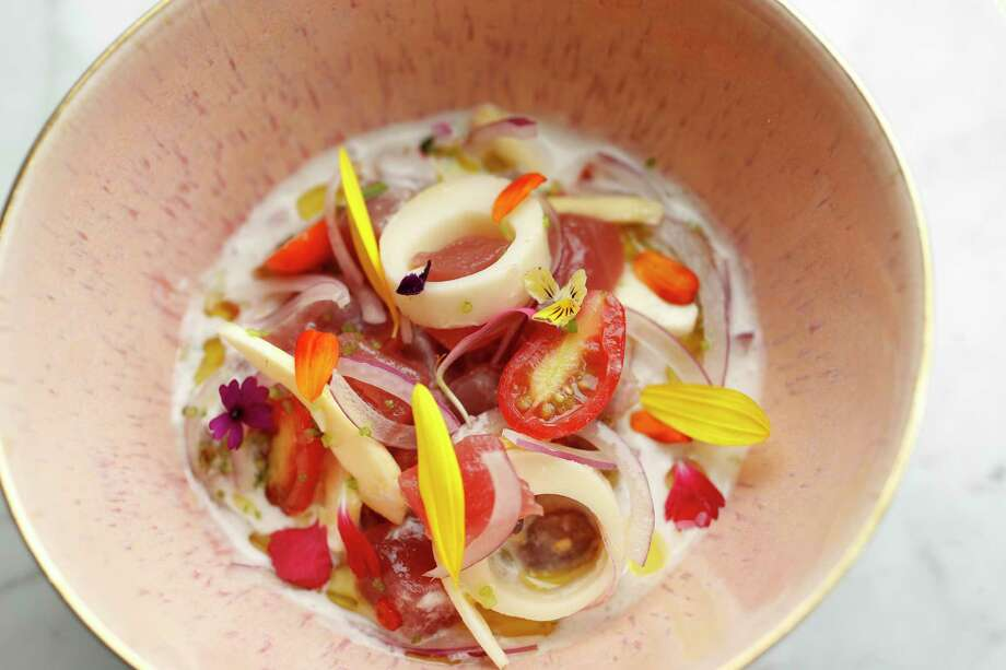 The Tuna Kinilaw: coconut, hearts of palm, jack fruit, coconut vinegar and coconut milk at James Beard Award-winning chef Paul Qui's new restaurant, Aqui, at 520 Westheimer. Photo: Karen Warren, Houston Chronicle / @ 2017 Houston Chronicle