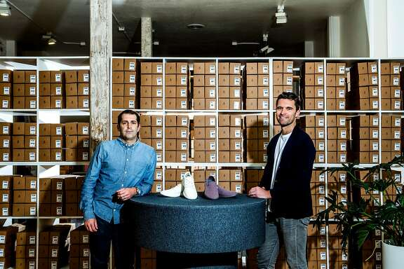Joey Zwillinger, left, a former clean-tech entrepreneur, and Tim Brown, the former vice captain of the New Zealand soccer team, at the headquarters of their startup, Allbirds, in San Francisco, Aug. 3, 2017. Allbirds makes the all-wool shoes that are found on nearly every foot in Silicon Valley. (Christie Hemm Klok/The New York Times)