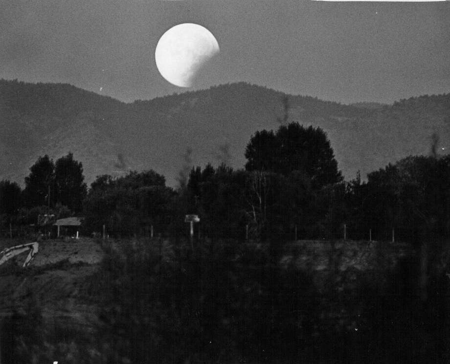 SEP 6 1979; Moon Coming Out of Earth's Shadow; The moon returns to visibility in the Denver area after a total eclipse Thursday morning. The scene is about 6:20 as the moon begins to descend behind mountains. The eclipse began at 2:21 and was total of 5:18. It was first total eclipse since 1975. There won't be another until 1982.;  (Photo By Bill Wunsch/The Denver Post via Getty Images) Photo: Bill Wunsch/Denver Post Via Getty Images