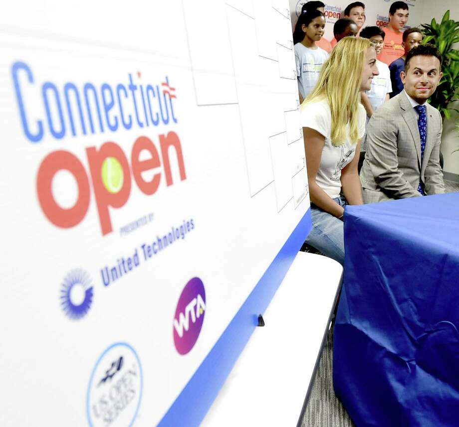 Two-time Wimbledon champion Petra Kvitova, left, and Jacob Harb, vice president of Porsche Area East during the Connecticut Open main draw ceremony Friday in the media press conference room at the Connecticut Tennis Center in New Haven. Photo: Peter Hvizdak / Hearst Connecticut Media / New Haven Register