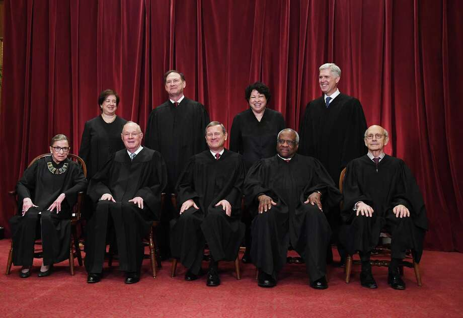 Seated from left, Associate Justice Ruth Bader Ginsburg, Associate Justice Anthony M. Kennedy, Chief Justice of the United States John G. Roberts, Associate Justice Clarence Thomas and Associate Justice Stephen Breyer. Standing behind from left, Associate Justice Elena Kagan, Associate Justice Samuel Alito Jr., Associate Justice Sonia Sotomayor and Associate Justice Neil Gorsuch pose for a portrait in the east conference room of the building of the Supreme Court. MUST CREDIT: Washington Post photo by Matt McClain Photo: Matt McClain / The Washington Post / The Washington Post