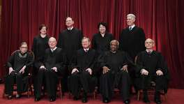 Seated from left, Associate Justice Ruth Bader Ginsburg, Associate Justice Anthony M. Kennedy, Chief Justice of the United States John G. Roberts, Associate Justice Clarence Thomas and Associate Justice Stephen Breyer. Standing behind from left, Associate Justice Elena Kagan, Associate Justice Samuel Alito Jr., Associate Justice Sonia Sotomayor and Associate Justice Neil Gorsuch pose for a portrait in the east conference room of the building of the Supreme Court. MUST CREDIT: Washington Post photo by Matt McClain