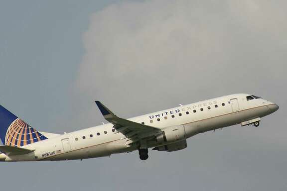 A United Express regional jet flight operated by Mesa Airlines takes off from Bush Intercontinental Airport in July 2017.