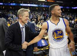 Steve Kerr and Stephen Curry (30) celebrate after the win as the Golden State Warriors played the Oklahoma City Thunder at Oracle Arena in Oakland, Calif., on Thursday, March 3, 2016. The Warriors defeated the Thunder 121-106 to tie the longest home winning streak at 44 games.