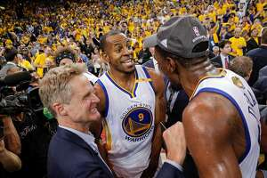 Golden State Warriors' Andre Iguodala, Head Coach Steve Kerr and Kevin Durant react after the Golden State Warriors defeated the Cleveland Cavaliers 129-120 in Game 5 to win the 2017 NBA Finals at Oracle Arena on Monday, June 12, 2017 in Oakland, Calif.