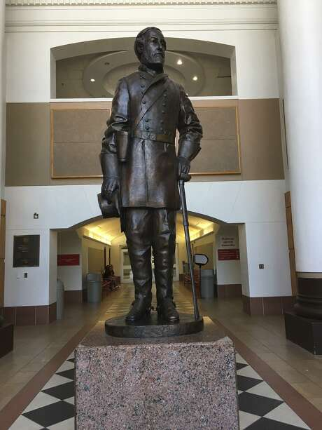 The statue of Confederate Gen. Robert E. Lee in the main entry foyer of Lee High School in San Antonio's North East Independent School District. Photo: Lauren Caruba /San Antonio Express-News / San Antonio Express-News