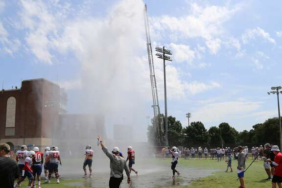 "University Park Fire Department assists the SMU football team with a ""wet ball"" drill on Friday, Aug. 18, 2017."
