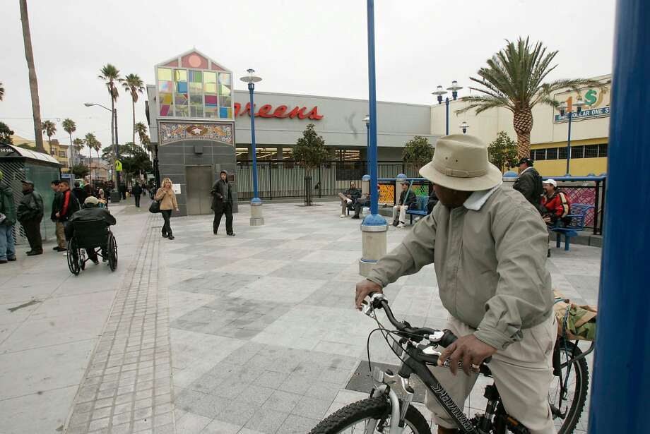 Street scene of the 16th St. Mission BART Station plaza, which a developer has been trying for several years to develop as housing. Photo: Christina Koci Hernandez, SFC