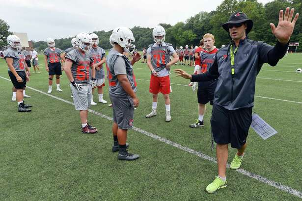 Greenwich Coach John Marinelli reviews plays with his team during the first day of fall football practice on Friday, August 18, 2017 at Greenwich High School for the 2017 FCIAC season.