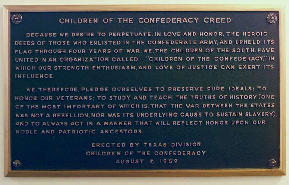 This is a view of the plaque bearing the Children of the Confederacy Creed mounted in a hallway inside the Texas Capitol near state Rep. Eric Johnson's office. Johnson, D-Dallas, is trying to get it removed, citing its historical inaccuracy in claiming slavery wasn't the reason for the Civil War. Photo: File Photo / AP