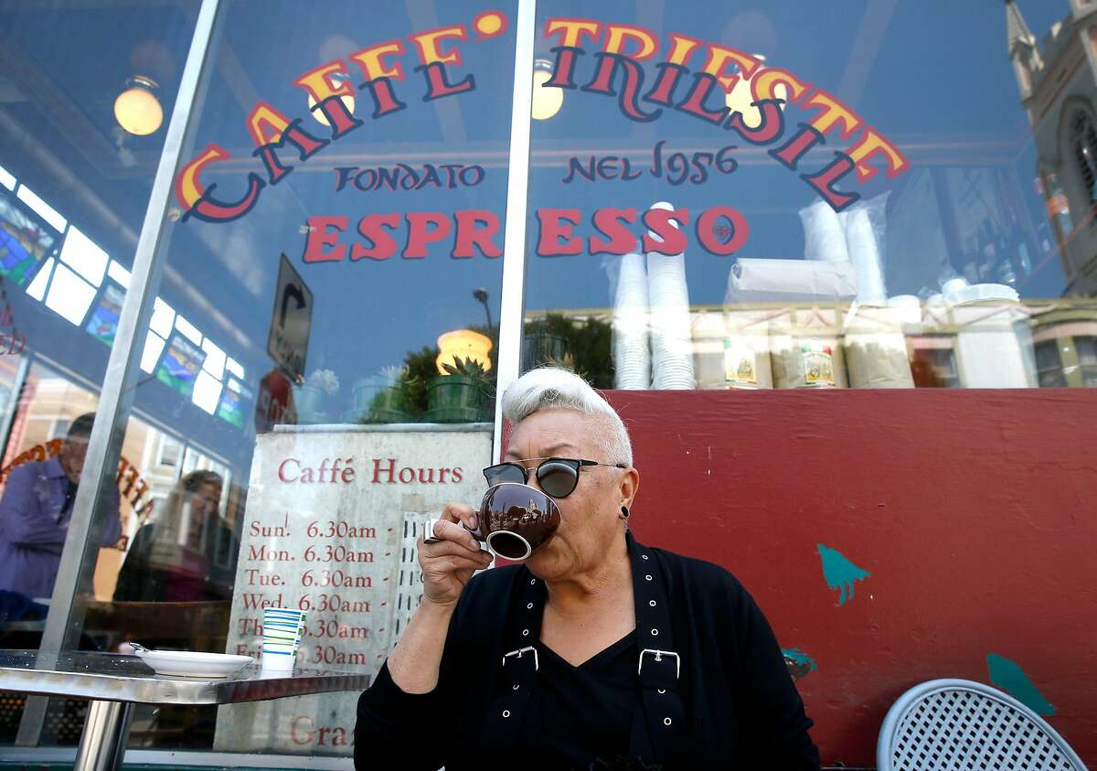 Paulette Baker, a longtime regular of Caffe Trieste, sips an Americano espresso in front of the venerable North Beach institution in San Francisco, Calif. on Thursday, Aug. 17, 2017.