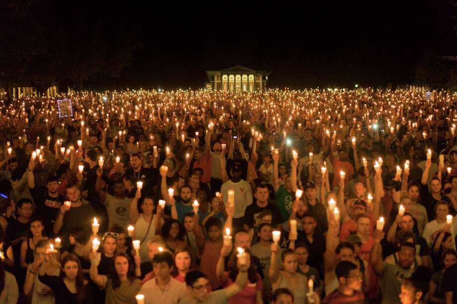 Thousands of people gather for a candlelight vigil on the University of Virginia campus in Charlottesville, Va. Marchers — many of them college students — sang hymns, gospel songs and other anthems of belonging at a gathering that was largely organized by word of mouth, striking a peaceful contrast to the torches wielded by white supremacists last week.. (Jason Lappa/The New York Times) Photo: Jason Lappa/The New York Times, STR / NYTNS