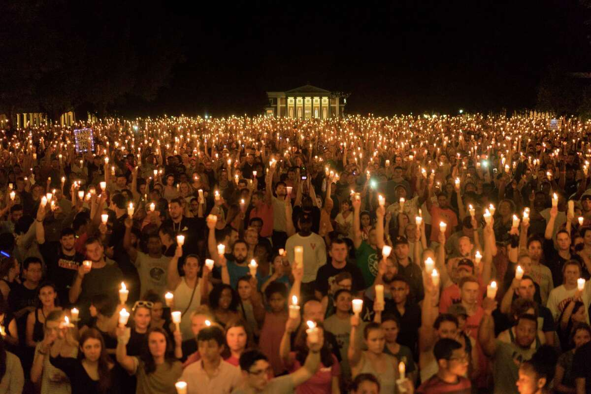 Thousands of people gather for a candlelightvigilon the University of Virginia campus inCharlottesville, Va. Marchers �- many of them college students �- sang hymns, gospel songs and other anthems of belonging at a gathering that was largely organized by word of mouth, striking a peaceful contrast to the torches wielded by white supremacists last week.. (Jason Lappa/The New York Times)