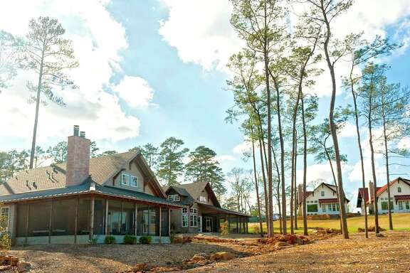 Bluejack National, a resort-style community and private club in Montgomery, offers various types of residences. Cottages, left, and member suites, right, are options for buyers of vacation properties.