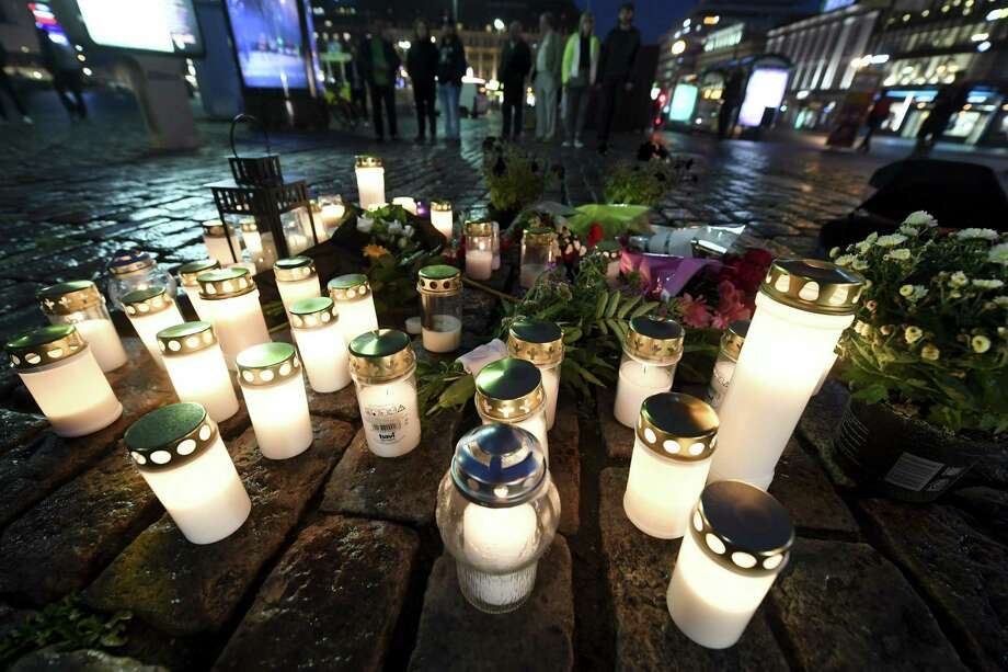 Memorial candles at the Market Square for the victims of Friday's stabbings in Turku, Finland, on Friday evening, Aug. 18, 2017. Several people were stabbed on the Market Square on Friday. (Vesa Moilanen/Lehtikuva via AP) ORG XMIT: LON859 Photo: Vesa Moilanen / Lehtikuva