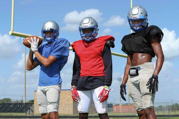 Willowridge High School football team players Vaughnte Frederick, left, Christian Carter and Daijuan Johnson will soon walk the halls with their rivals.