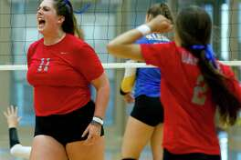 Oak Ridge's Carly Graham (11) celebrates after scoring a point in the first set of a non-district high school volleyball game at Klein High School, Friday, Aug. 18, 2017, in Klein. Oak Ridge defeated Klein in striaght sets.
