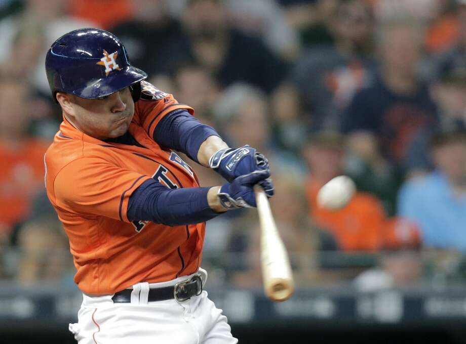 Houston Astros second baseman Jose Altuve (27) connects for a solo home run in the bottom of the third inning, making the score 2-0 Houston. Houston Astros host the Oakland Athletics at Minute Maid Park on  Friday, Aug. 18, 2017, in Houston. ( Elizabeth Conley / Houston Chronicle ) Photo: Elizabeth Conley/Houston Chronicle
